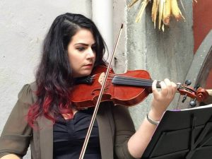 Sylvia Sippl playing violin for a wedding in Italy.